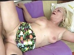 Young guy pounds adult blonde with stockings