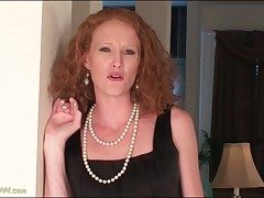 Skinny redhead mummy disrobes off her little ebony dress