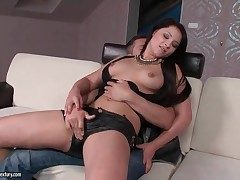 Dame in sexy leather cut-offs gives a lap dance
